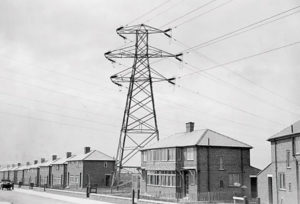 A pylon between houses in a new-build housing estate